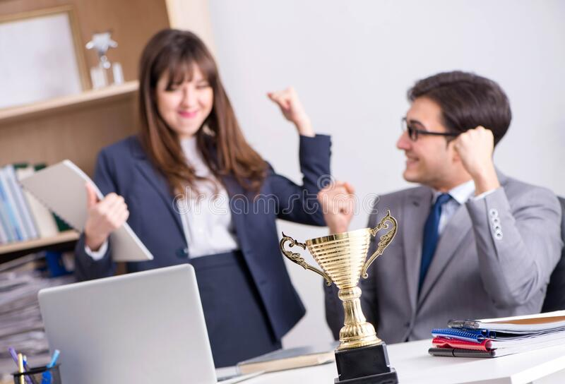Concept of teamwork with prize. The concept of teamwork with prize stock image