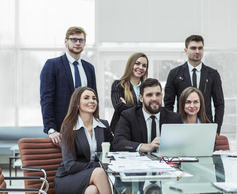Concept of teamwork - a successful business team in the workplace in the office stock photo