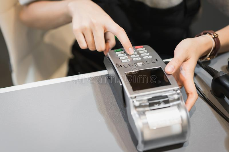 Concept of technology in buying without using cash. Close up of hand use credit card swiping machine to pay stock image