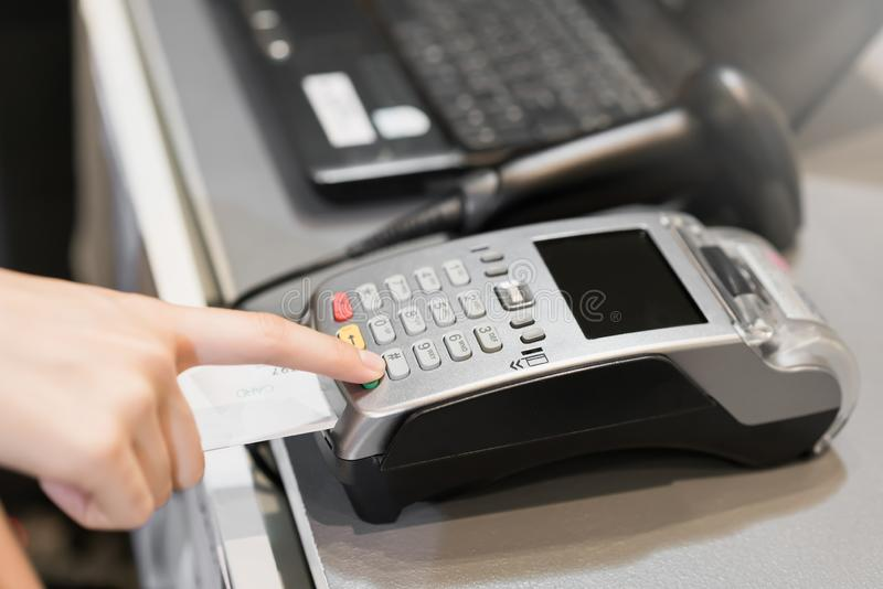 Concept of technology in buying without using cash. Close up of hand use credit card swiping machine to pay.  stock photography