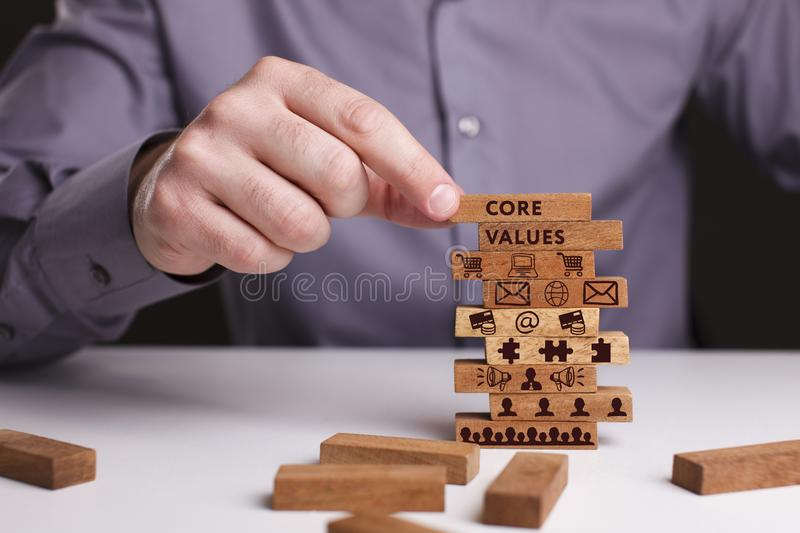 The concept of technology, the Internet and the network. Businessman shows a working model of business: Core values royalty free stock images