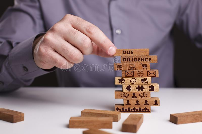 The concept of technology, the Internet and the network. Businessman shows a working model of business: Due diligence royalty free stock image