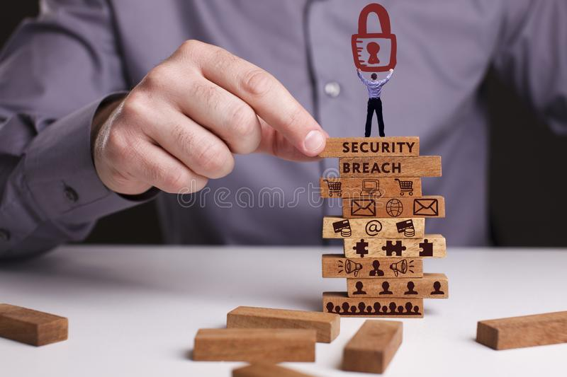 The concept of technology, the Internet and the network. Businessman shows a working model of business: Security breach stock image