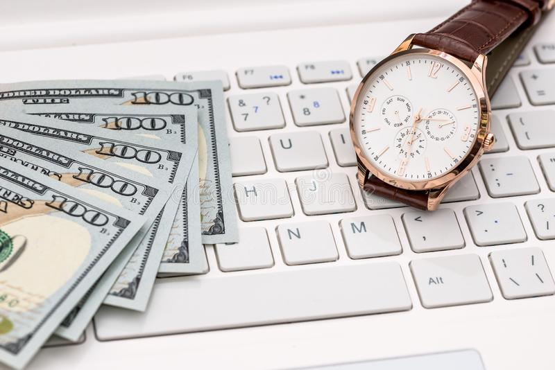 Concept time - money, dollar notes and hand watch royalty free stock photography
