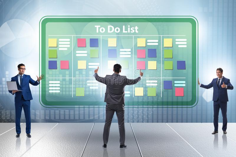 Concept of to do list with businessman stock photography