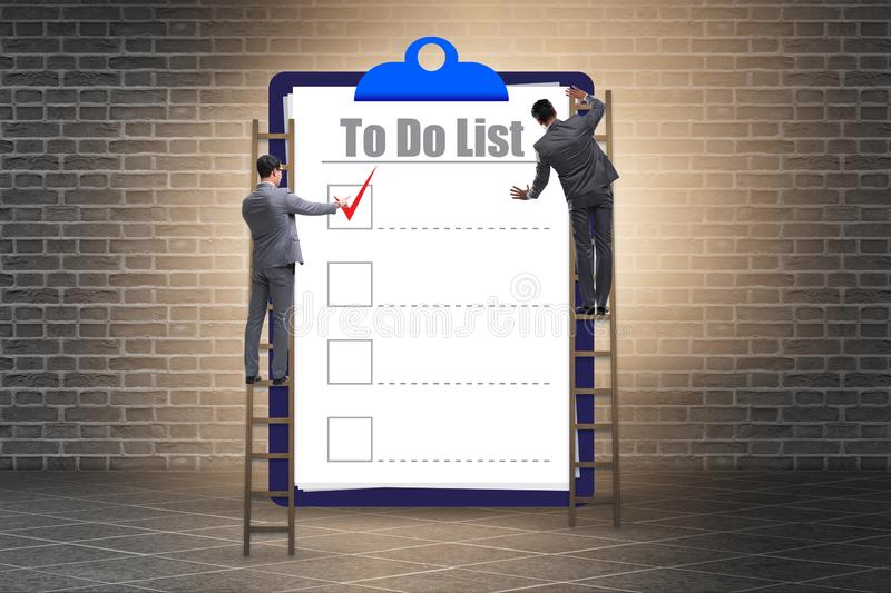 Concept of to do list with businessman stock photos