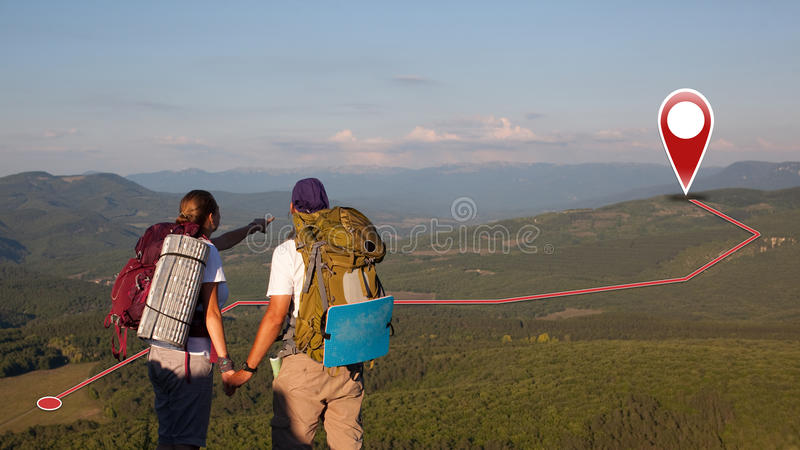 Concept of tourists couple with GPS Icons royalty free stock images