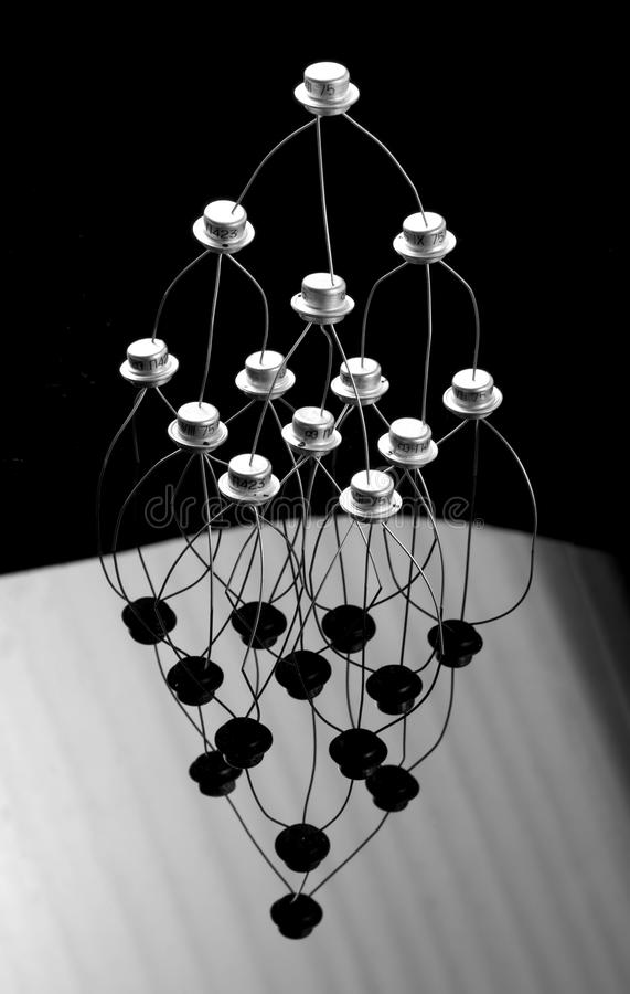 Concept of transistors. Acrobats pyramid on black and white stock images