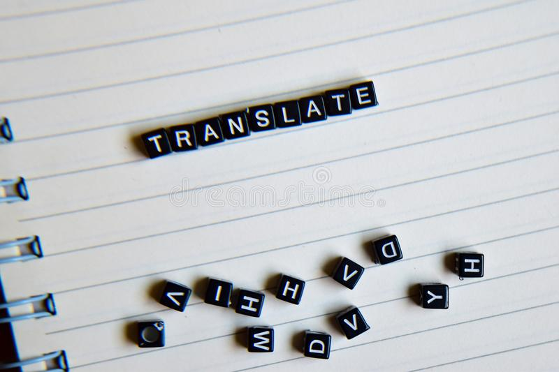 Concept of Translate word on wooden cubes with books in background stock photos