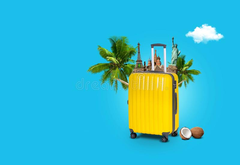 Concept travel. A suitcase with world sights with palm trees. On a blue background. Holidays and vacations stock photo