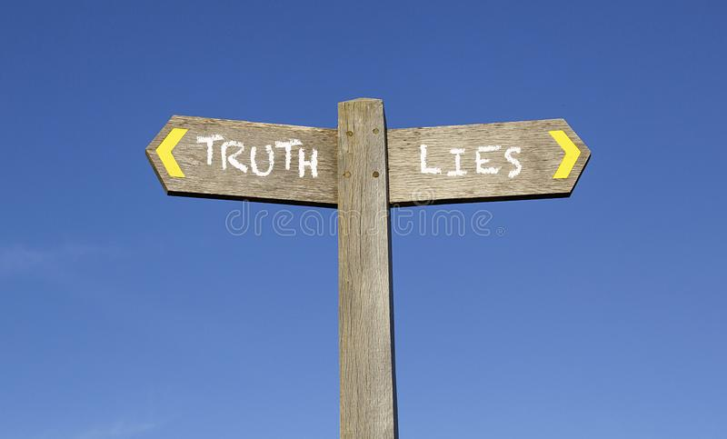 Truth and Lies - Conceptual signpost with a blue sky background stock photos