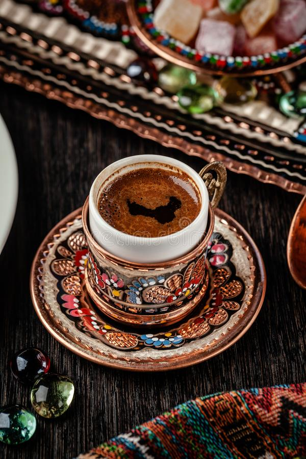 The concept of Turkish cuisine. Turkish brewed black coffee. Beautiful coffee serving in the restaurant. Background image royalty free stock photos