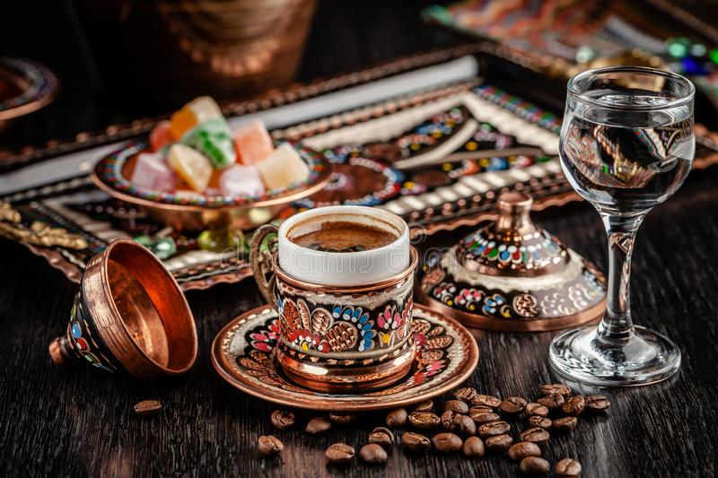 The concept of Turkish cuisine. Turkish brewed black coffee. Beautiful coffee serving in the restaurant. Background image stock images