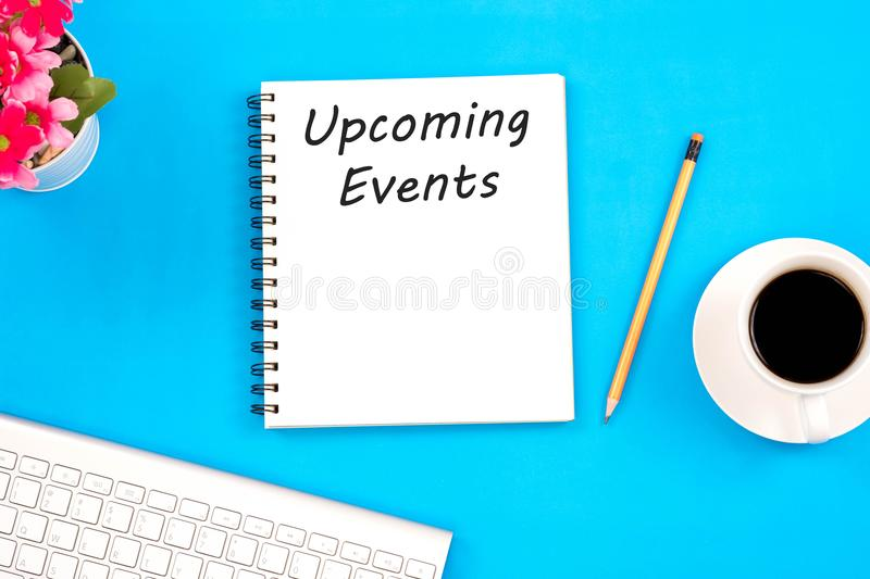 Concept Upcoming Events message on notebook, keyboard,with penci royalty free stock photography