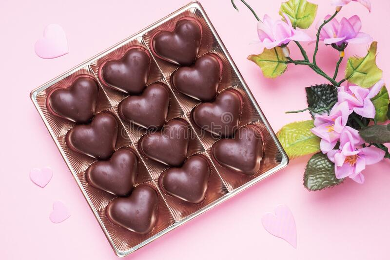 Concept Valentine`s Day. Chocolate candies, hearts on a pink background.  stock images