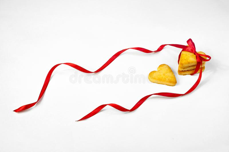 Concept Valentine`s Day. Cookies in the Shape of Hearts Tied with a Red Ribbon. Sweet Gift on Light Background. Banner. Copy Spac. E For Your Text royalty free stock image