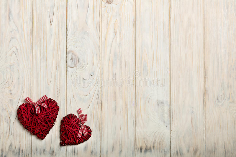 Concept Of Valentine's Day. Wicker hearts on wooden background w stock photo