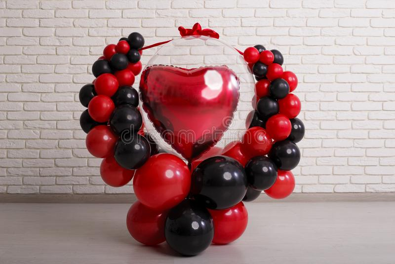 Concept for valentines day. The design of the balloons is black-red with a big heart in the center. bandaged festive ribbon stock photo