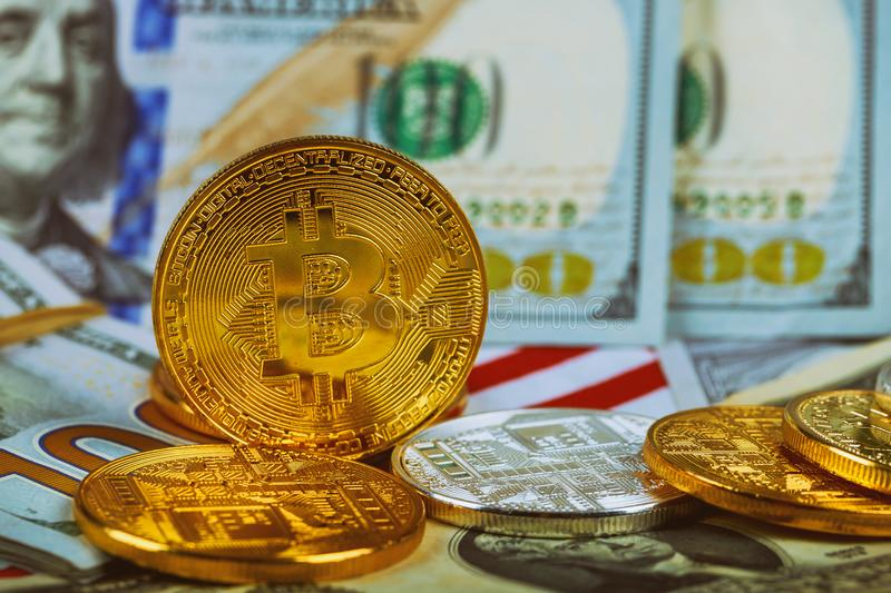 The concept of the value of the crypto currency. golden bitcoin coin on us dollars close up royalty free stock photos