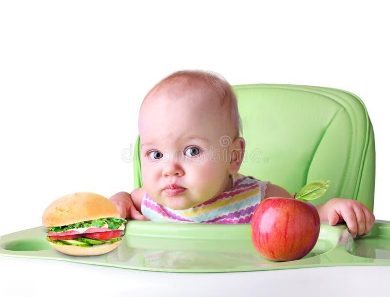 Concept van de kind` s het gezonde voeding Baby die voedsel eet Geïsoleerde royalty-vrije stock foto