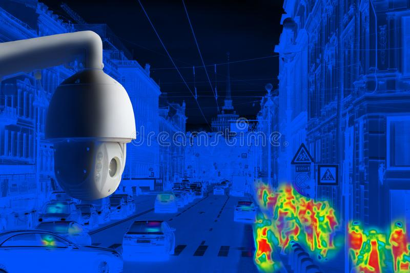 The concept of video surveillance and security technology. CCTV camera on the background of the city road with cars, pedestrian stock images