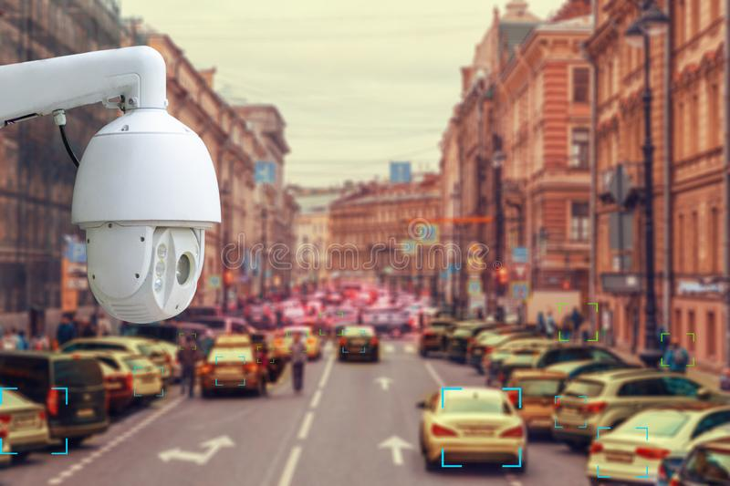 The concept of video surveillance and security technology. CCTV camera tracks violators of traffic rules during traffic congestion stock photos