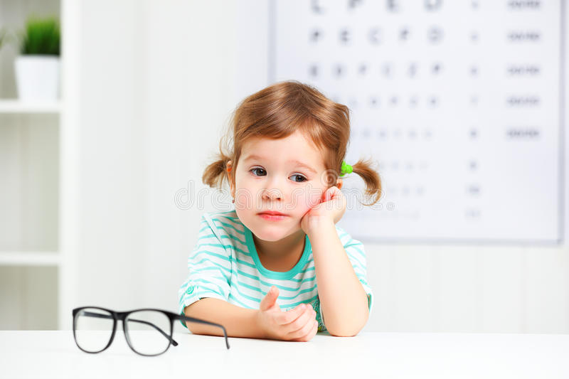 Concept vision testing. child girl with eyeglasses royalty free stock images