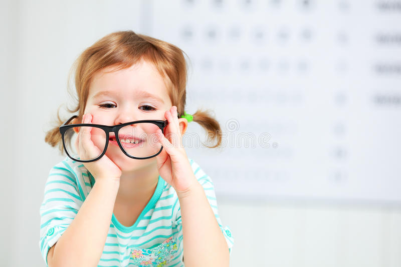 Concept vision testing. child girl with eyeglasses royalty free stock photography