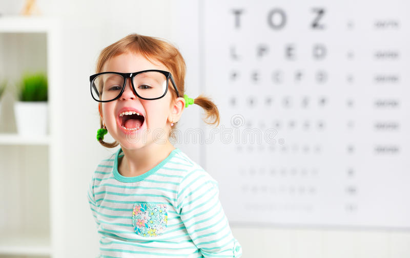 Concept vision testing. child girl with eyeglasses stock photos