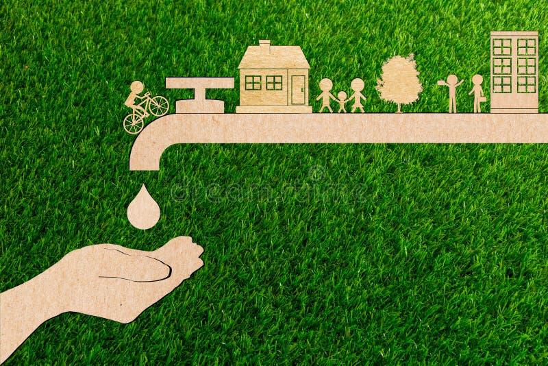 Concept vivant d'écologie d'économies d'eau du robinet de gouttelette de coupe de papier photo stock