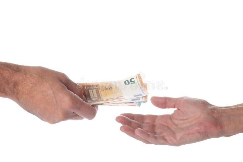 Concept voor betaling en uitwisseling van geld: twee handen, één die geld geeft en één die geld ontvangt Euro currency geïsoleerd royalty-vrije stock foto's