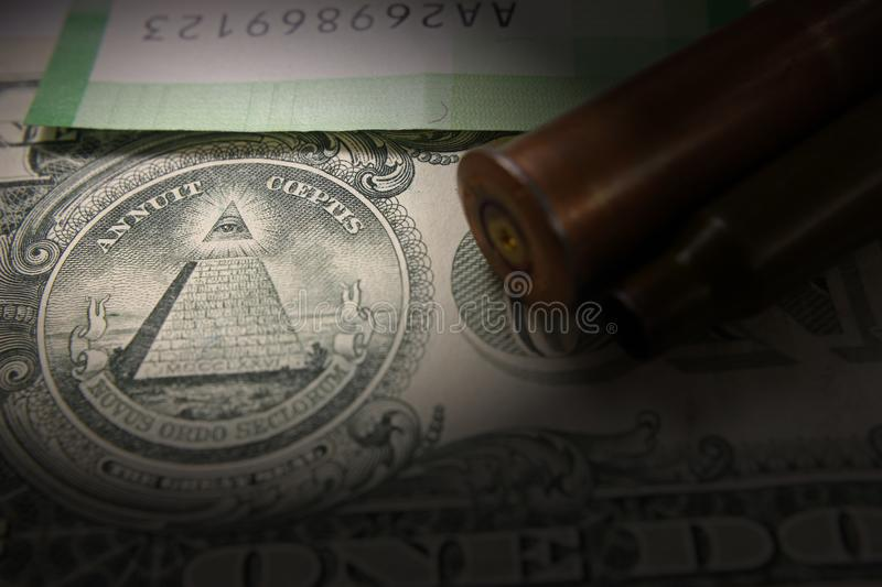 The concept of war. Expenses for armament. Military bullet of shells, money, dollar, vignette stock photos