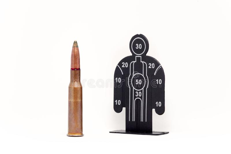 A bullet and human shape target royalty free stock photo