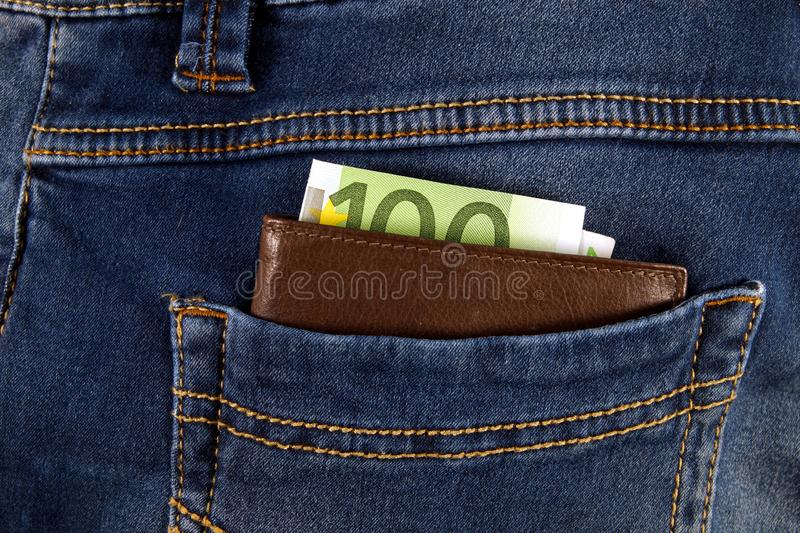 Euro money cash, euro banknotes in the leather wallet in the pockets of jeans trousers. banner for web, gift card, postcard. Concept of wealth, saving or stock photography