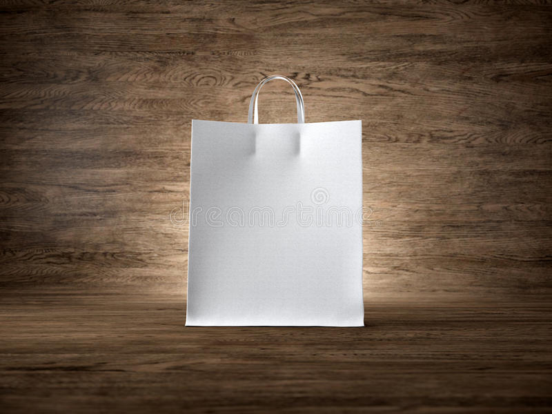 Concept of white craft shopping bag wooden. White craft shopping bag on the wooden background. Focus on the shopping bag. Horizontal stock photography