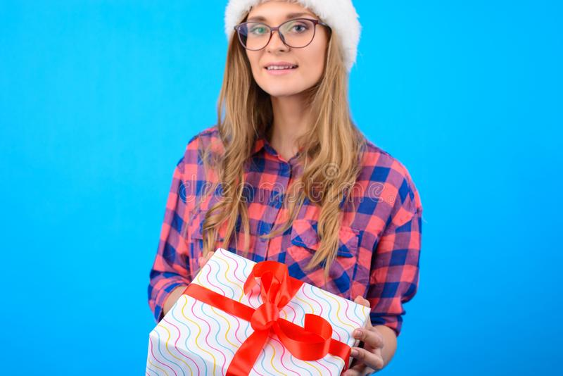 Concept of winter holidays and getting presents. Cute girl in ch stock images