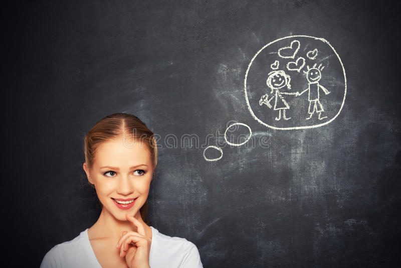 Concept. woman dreams about love and marriage drawing on a chalk royalty free stock photography