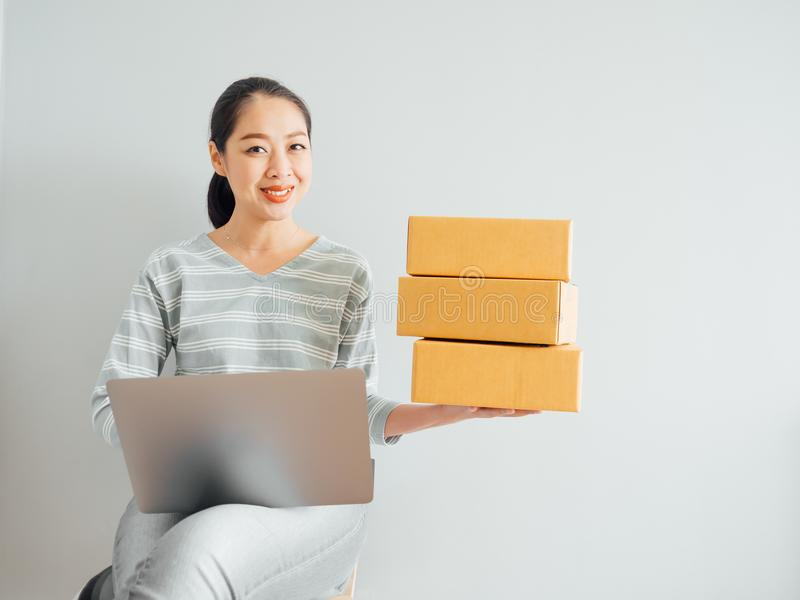 Concept of woman happy with her online business sale. Concept of Asian woman happy with her online business sale royalty free stock photos