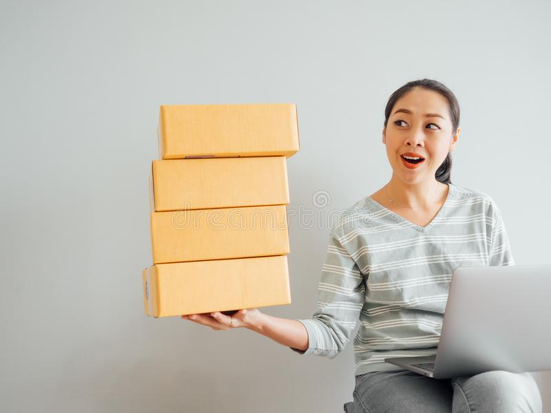 Concept of woman happy with her online business sale. Concept of Asian woman happy with her online business sale royalty free stock photo