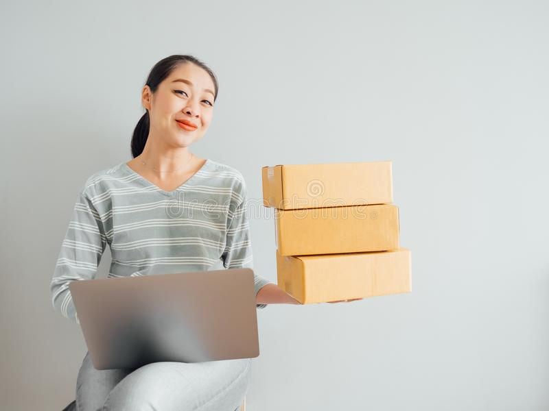Concept of woman happy with her online business sale. Concept of Asian woman happy with her online business sale. smart box home adult modern successful royalty free stock photography