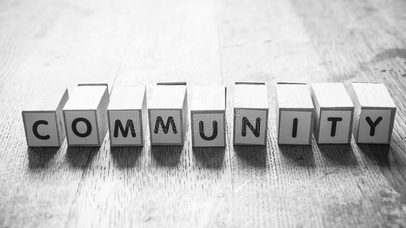 Concept word on cube - Community. Concept word on cube on wooden desk - Community royalty free stock images