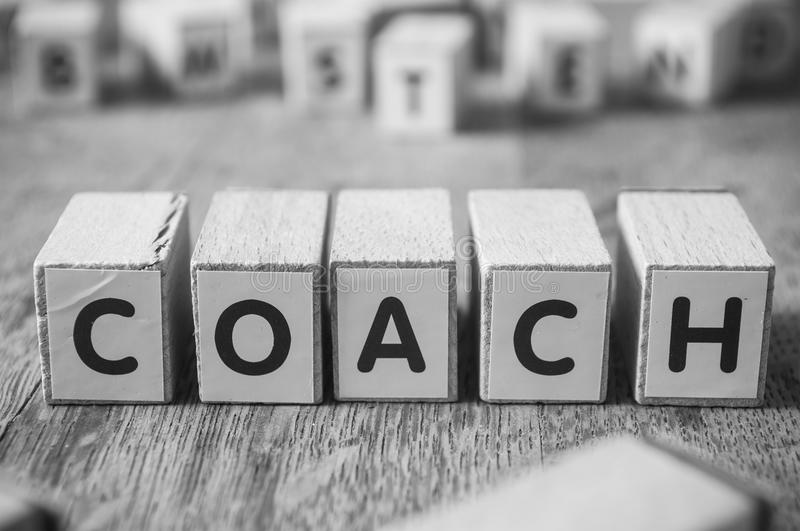 Concept word on cube - coach stock photo
