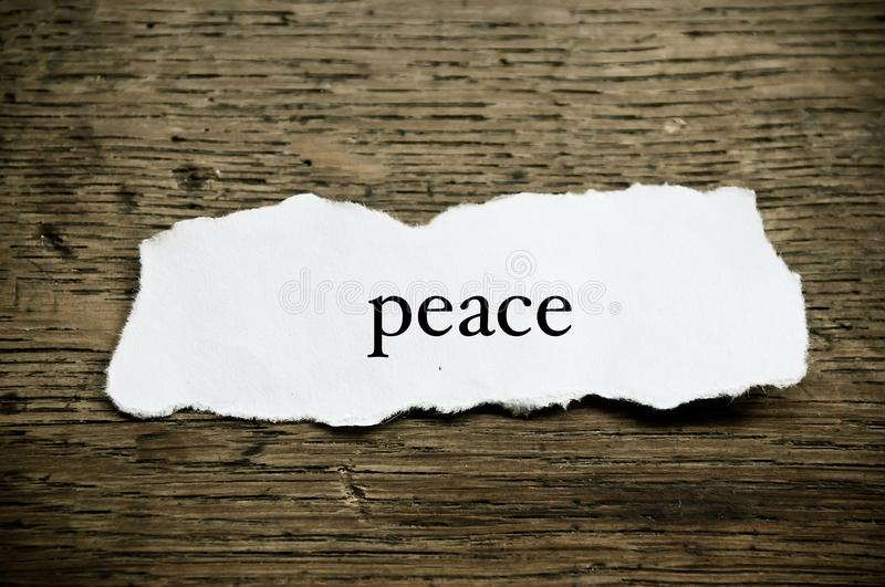 Concept word on paper on wooden desk - Peace royalty free stock image