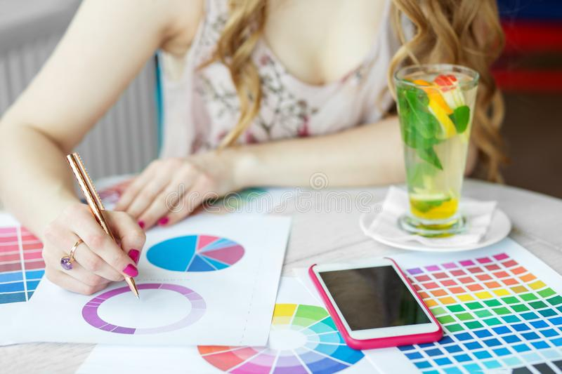 A woman writes and works. Smartphone. The concept of work, business, education, freelance, lifestyle. A woman writes and works. Smartphone. The concept of work royalty free stock photos