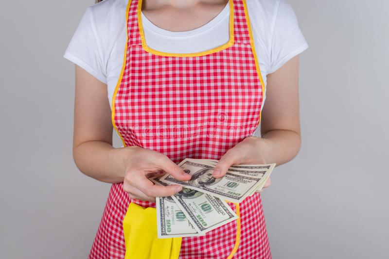 Concept of working hard. Cropped close up photo of satisfied happy smart girl holding stack of money isolated grey background stock photos