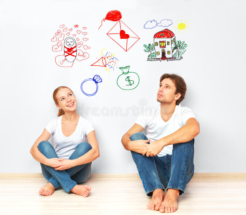 Concept. young couple dreaming of new house, child, financial well-being stock photography