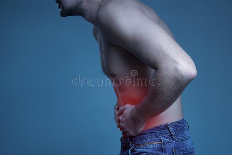 Conceptenziekte Pijn in maag stock afbeelding