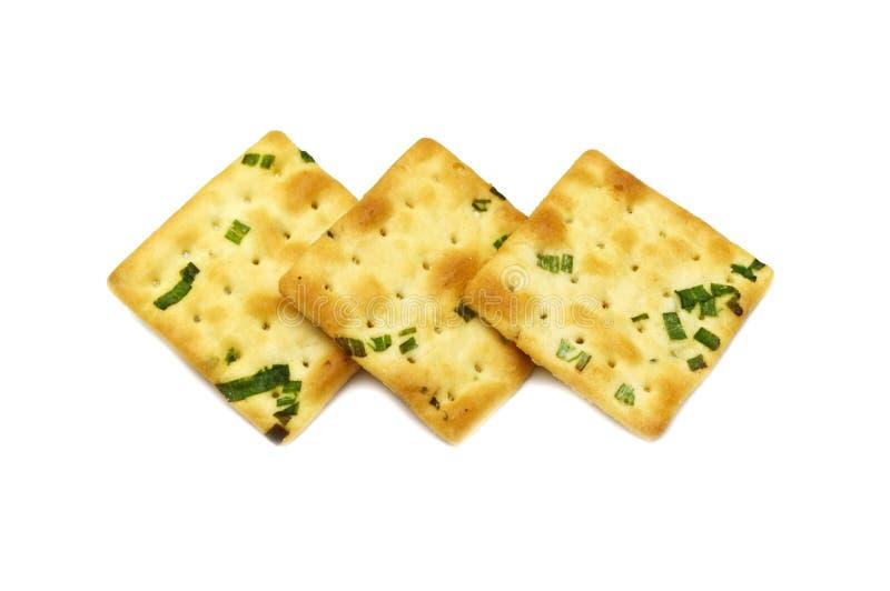 Conception carrée de biscuit de biscuits Grande combinaison de saveur d'oignon vert et de blé photographie stock libre de droits
