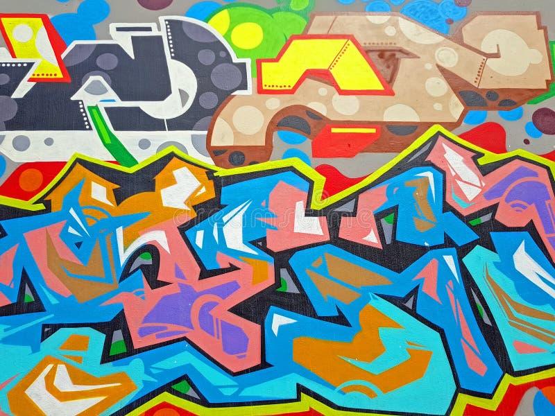 Conception de graffiti sur un mur images stock