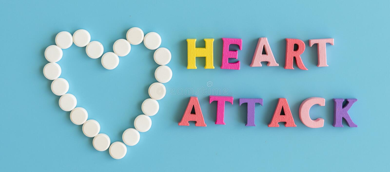Conception of a heart attack. The inscription on a blue background is a heart attack royalty free stock photos